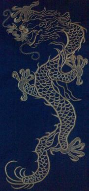 Dragon Embroidered on the back of Denim Jacket.